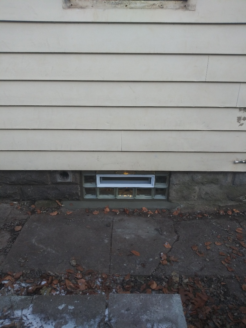 Lansing, MI - Replacing basement rotted wood framed window with new glass block