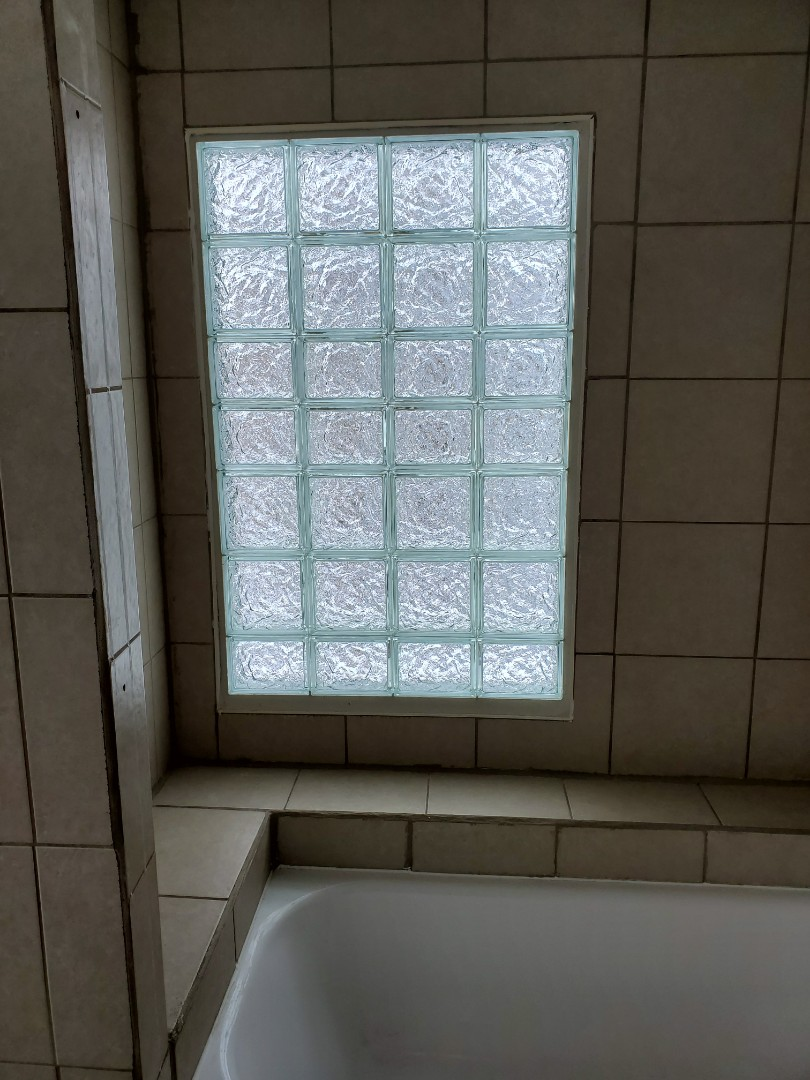 Lansing, MI - Replace old broken glass block window with new glass block window in homeowners 2nd story shower