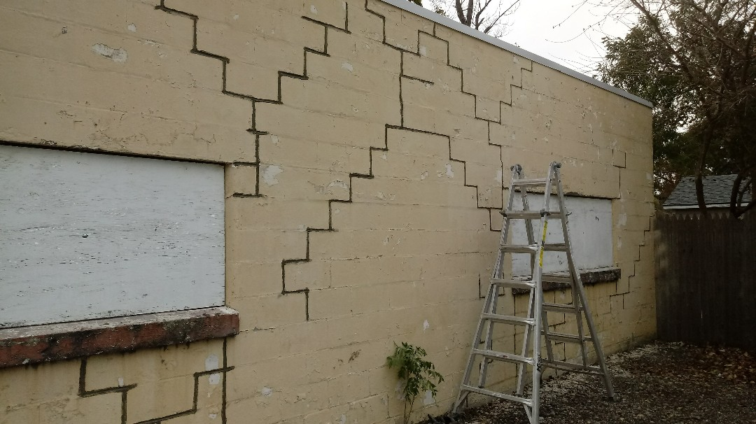 Kalamazoo, MI - Tuck pointing a block building to seal all open mortar joints before it gets painted.
