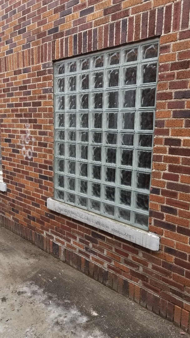 Grand Rapids, MI - Replaced old broken window with new glass block window at a business