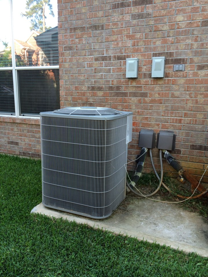 The Woodlands, TX - Air conditioner repair service call. Carrier AC repair needed to replace the unit run capacitor.