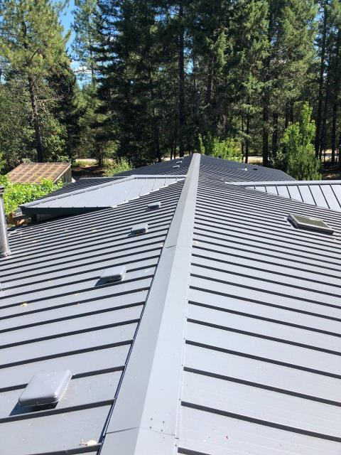"""Cave Junction, OR - Another awesome installation of a Taylor Metals 12"""" Easy Lock standing seam metal roof."""