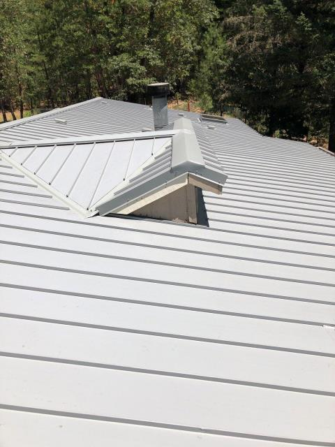 """Rogue River, OR - Doing the inspection on this Taylor Metal 12"""" Easy Lock standing seam metal roof in Sterling Gray. Another fantastic installation."""
