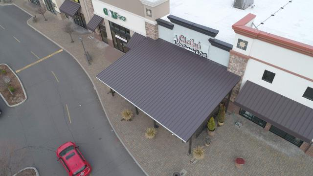 Medford, OR - We just completed the roof on this beautiful porch for Cicily's by installing a the Bruce and Dana Snap Lock metal panels. This will certainly help the outdoor seating situation here.
