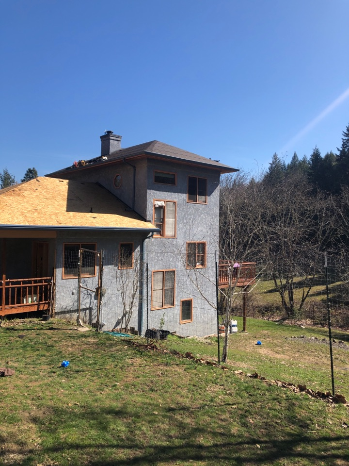 Talent, OR - Installing a Taylor Metals Easy Lock roof. The Tahoe Blue color is going to make this house pop.