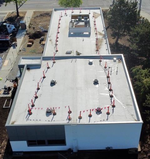 Medford, OR - Pressure Point's Commercial Crew completed this job with (2) layers of 2.6 Poly ISO to create an R-30 Value. Then a 60 Mil. White TPO roofing system is applied over the Poly ISO to complete this roof with a 20 year Warranty.