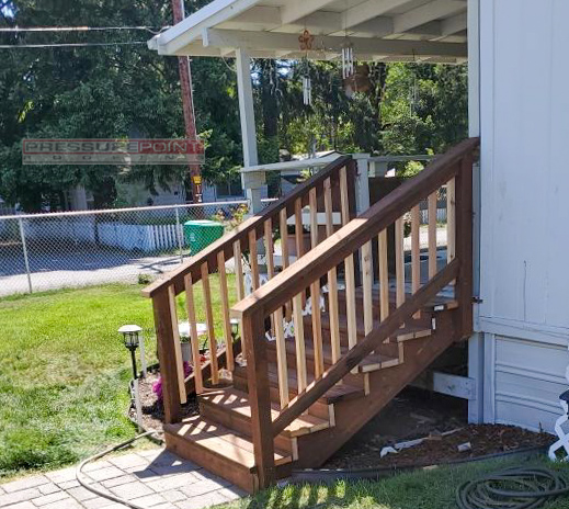Shady Cove, OR - Our Construction Crew replaced (2) old stair way's with (2) new one's using Pressure Treated Lumber for the Stairs, Stringer, and railing's. 2x2 Cedar Pickets were used for the Baluster to give it this nice clean look.  #pressurepointroofing