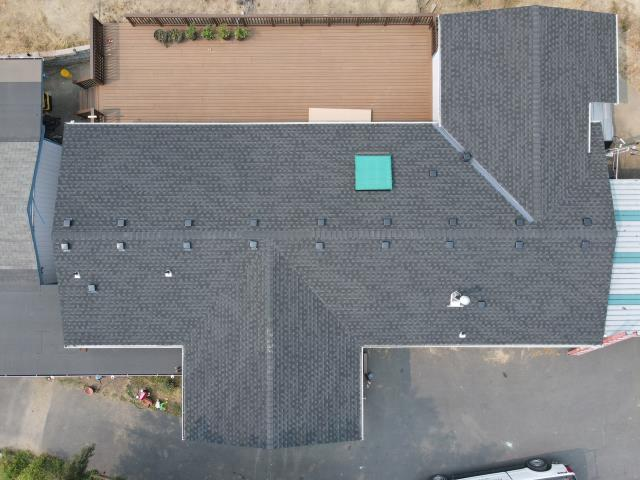 Grants Pass, OR - Inspecting a recent Re-Roof job Pressure Point Roofing completed with GAF Timberline HDZ Shingles (Charcoal)