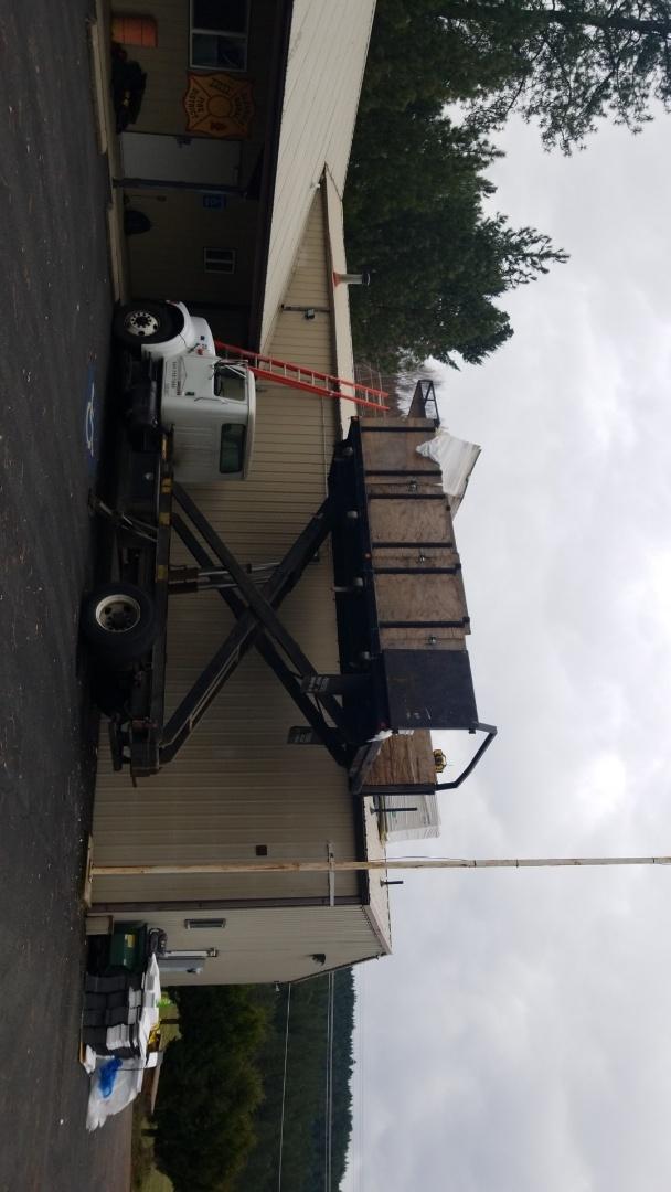 Roseburg, OR - Installing Duro-Last 50mil PVC membrane roof. Over a metal ag panels.