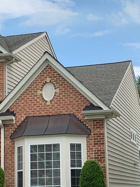 Havre de Grace, MD - Replaced front lower roof slope using Tamko Heritage Weathered Wood shingles to match the rest of the house and finally resolving a long standing roof leak issue this client has endured since the house was built.  #roofreplacement #roof #roofer #tamkoshingles