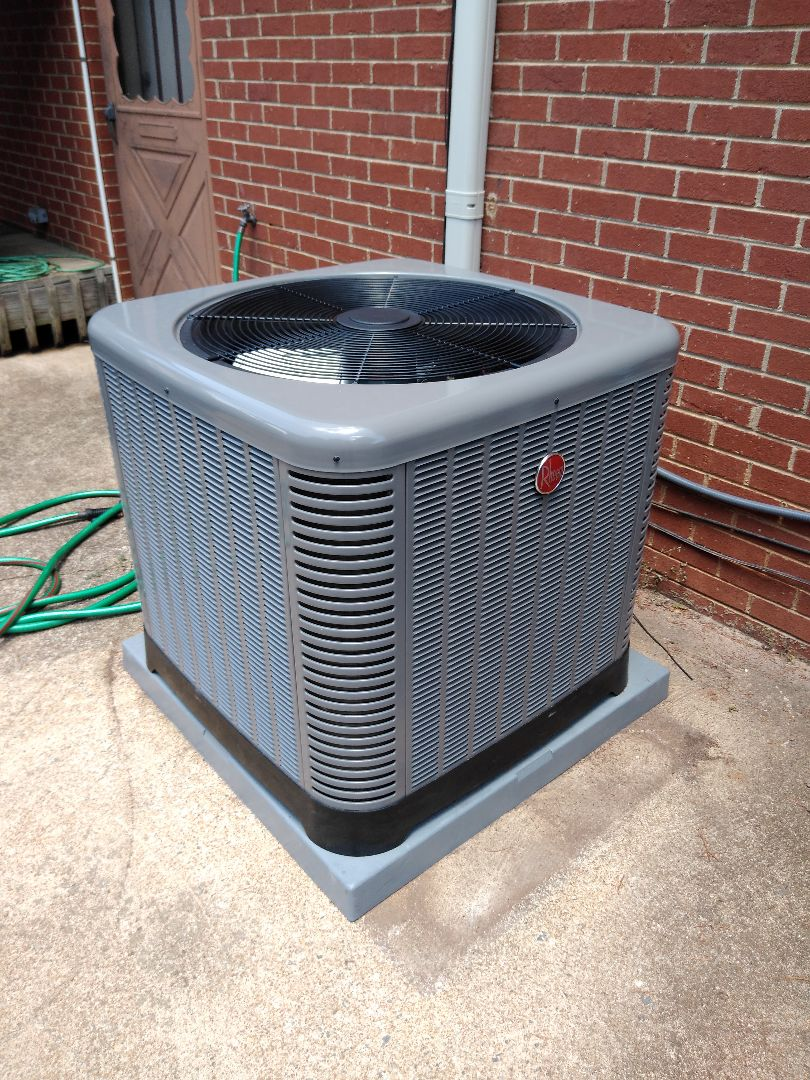 Installation of a new Rheem heat pump in Newton.