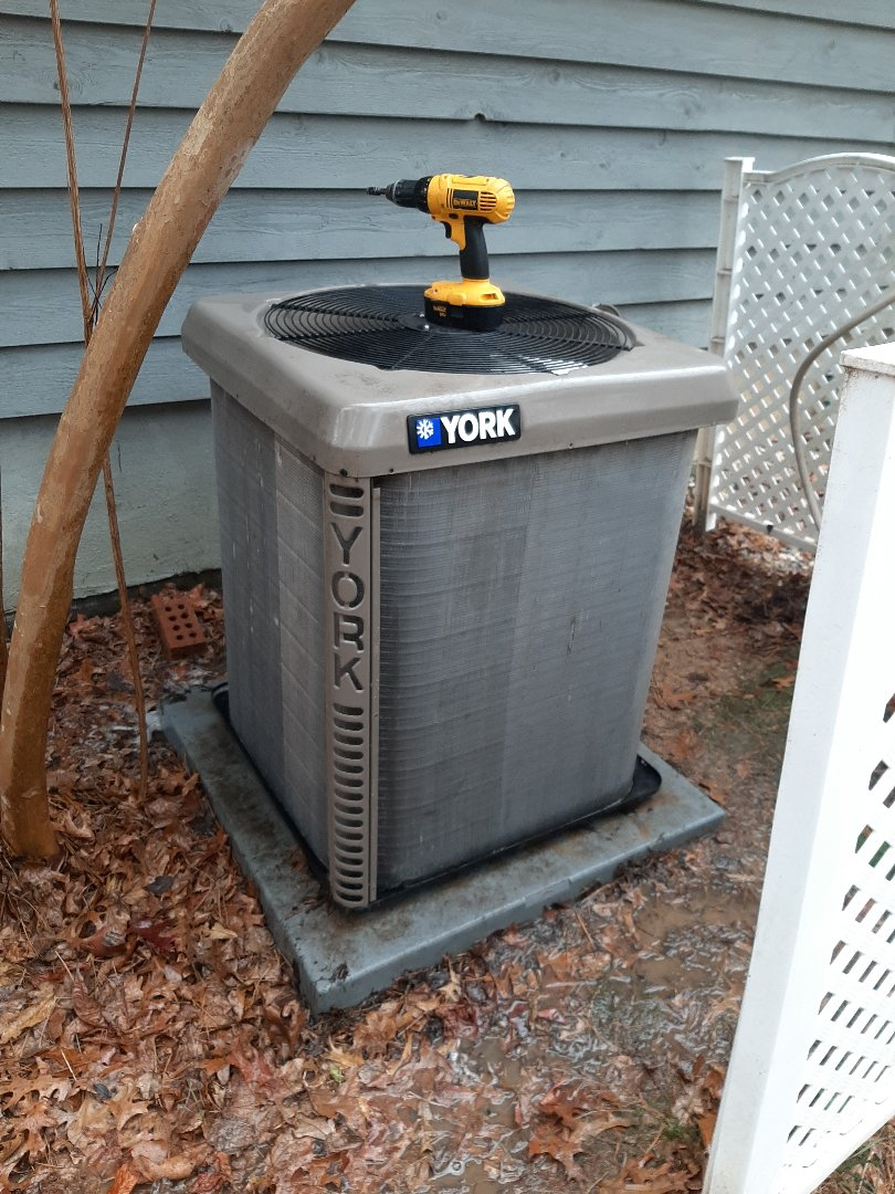Hickory, NC - Putting this outdoor unit back together after cleaning the coils. Another happy MPP customer!!
