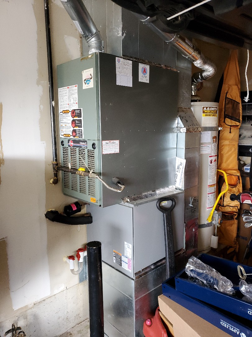 La Center, WA - Service and cleaning on a dual fuel system. Gas furnace Rheem, and a heat pump Tempstar.