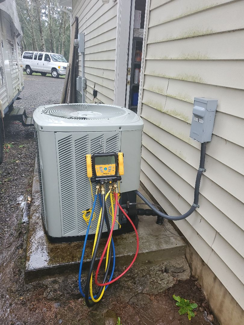 Amboy, WA - Performed a service and cleaning on a Trane heat pump and air handler. Comfort club annual maintenance agreement.