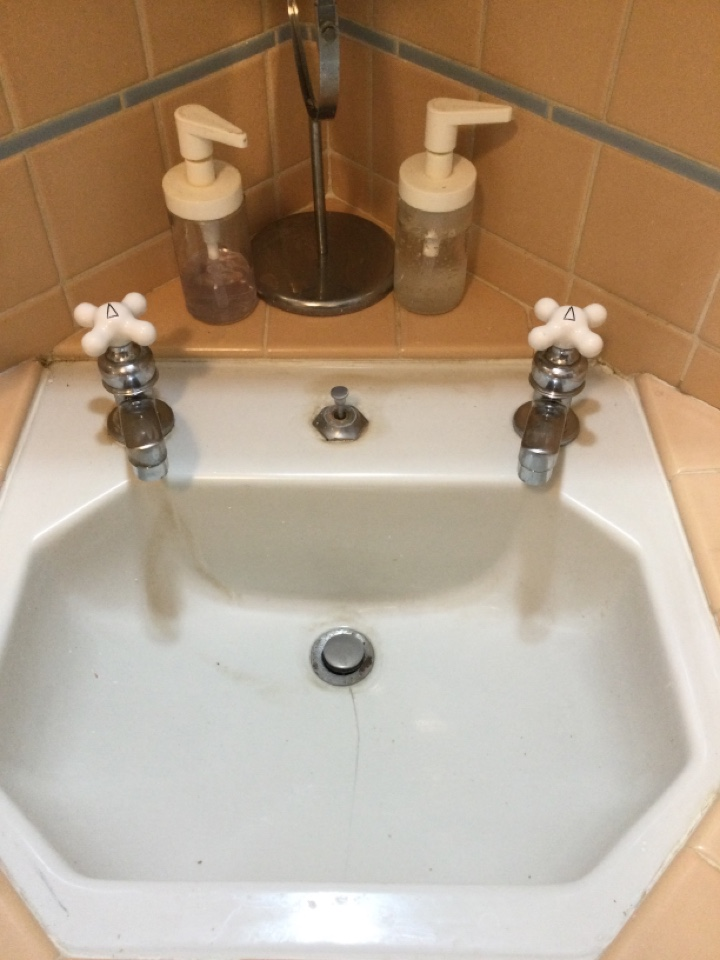 Glendale, CA - Performing plumbing repair on lavatory Delta faucet and replacing angle stops with supply lines