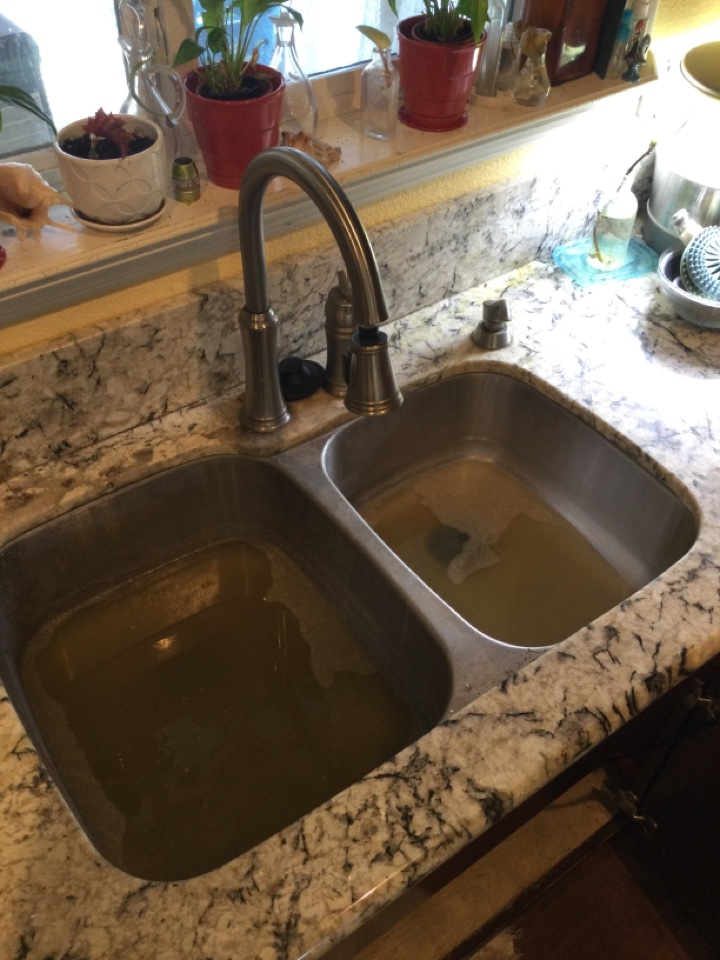Glendora, CA - Plumber working on clearing clogged kitchen sink