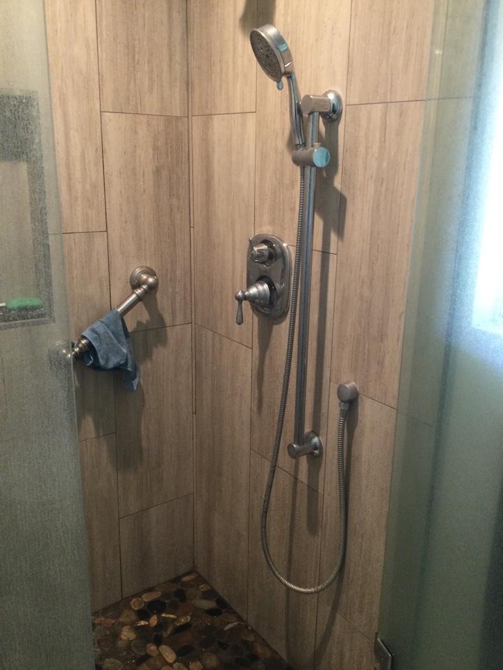 Plummer performing repairs on Moen shower valve shower was leaking