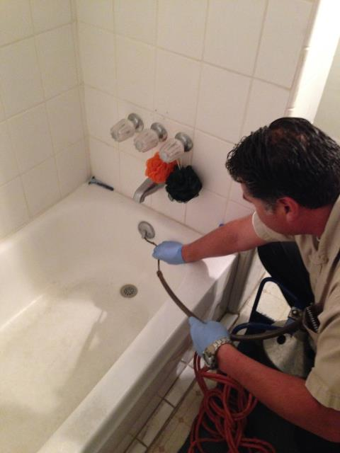 Azusa, CA - Found plugged tub drain, plugged sewer line. Snake sewer and snake tub drain. Clear stoppage. Service with Bio Clean.