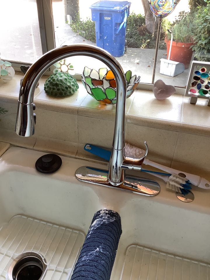 Arcadia, CA - Best Plumber in the area working on Replacing Faulty Kitchen Faucet With New Kohler kitchen faucet also replacing leaky garbage disposal installing new Insinkerator 1/2HP also Replacing Old Lav Faucet with New Price Pfister widespread Lav faucet