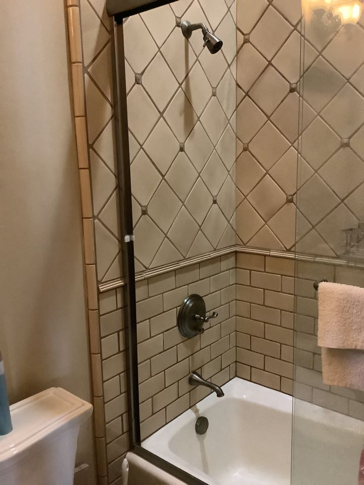 Monrovia, CA - Plumber working on leaky tub shower control that is faulty parts are special order Grohe
