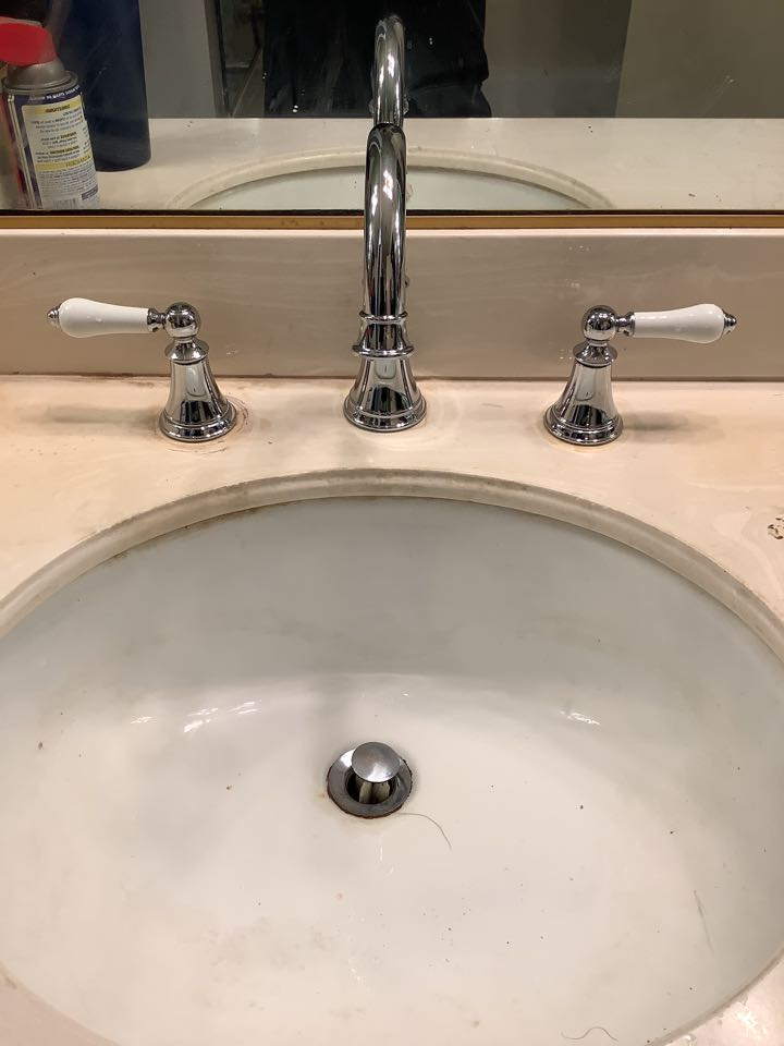 Arcadia, CA - Best Plumber in the area Working on Replacing widespread Lav Faucet that is faulty and leaking Installing New Price Pfister widespread