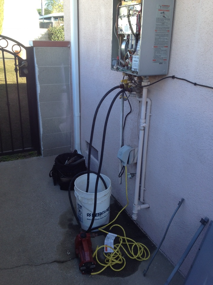 West Covina, CA - Tankless water heater service call. Flushing of Rinnai R75-LSe tankless water heater. Performed annual service and inspection of unit.