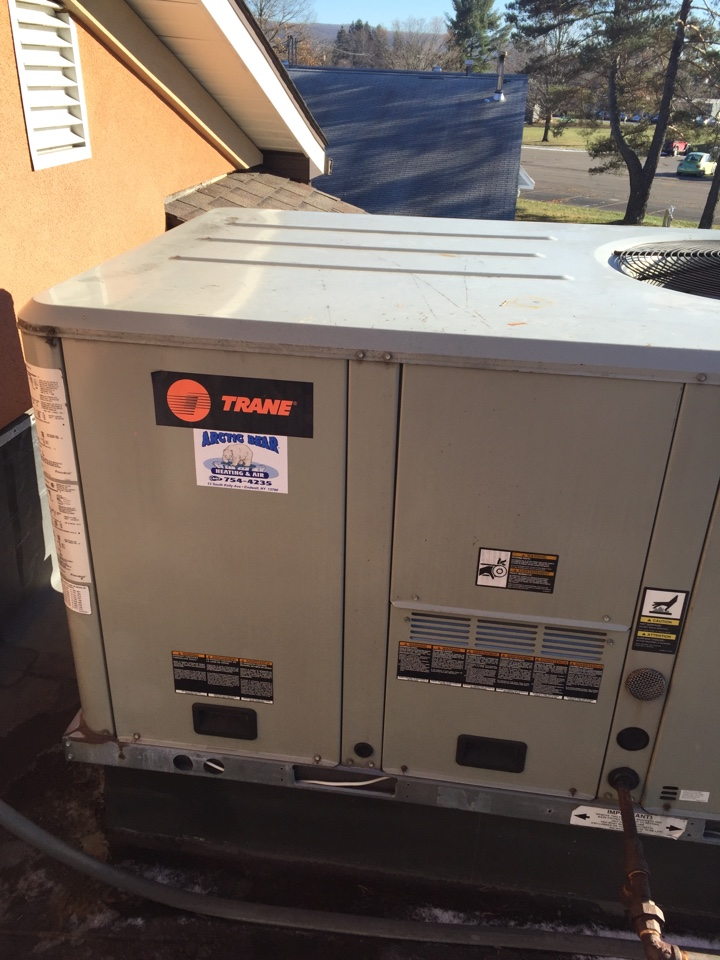 Conklin, NY - Performing annual heating system preventive maintenance on a Trane rooftop heating and air conditioning unit.