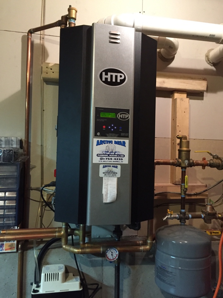 Harpursville, NY - Performing annual heating system preventive maintenance on an HTP wall hung gas boiler.