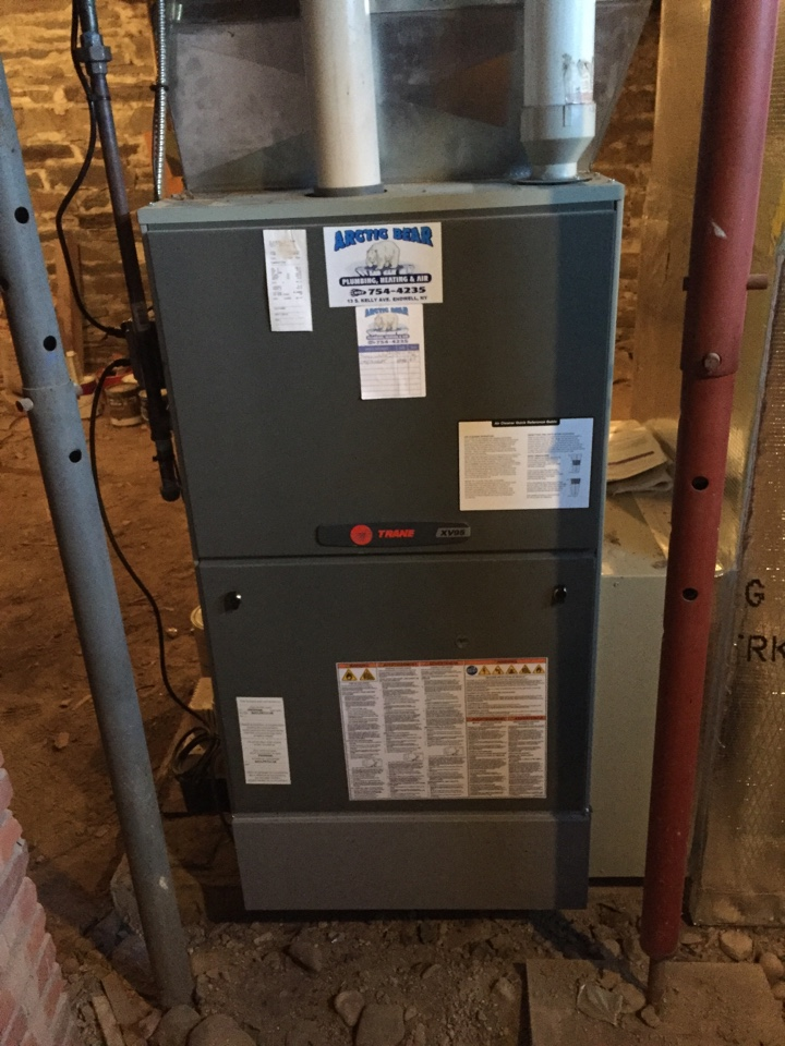 Lisle, NY - Performing annual heating system preventive maintenance on a Trane gas furnace and installing a UV light.