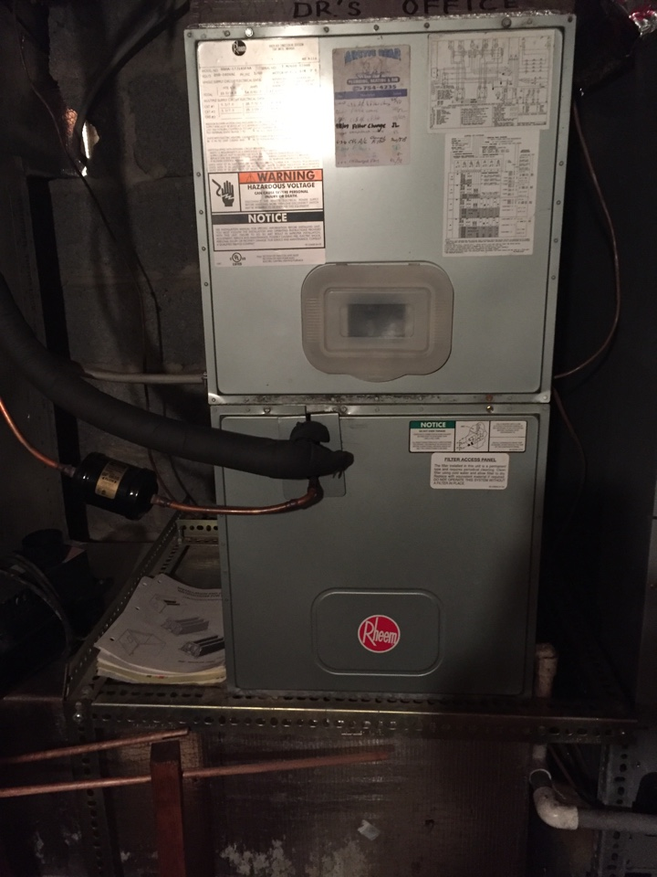 Laceyville, PA - Air filter replacement on a Rheem heat pump.