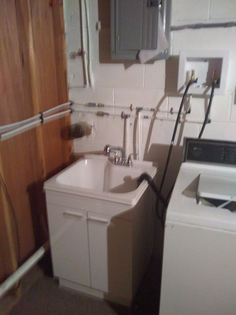 Install brand new laundry tub in Lake Orion Michigan