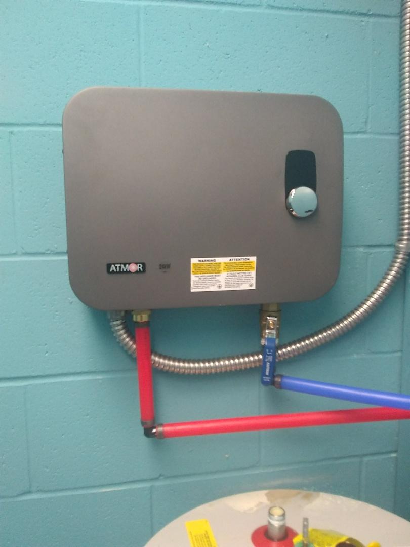 Changing water heater in Auburn