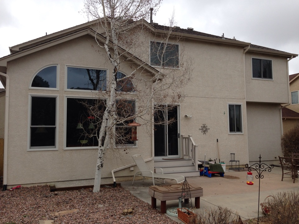 Colorado Springs, CO - Very happy customers who replaced hail damaged vinyl windows with Renewal by Andersen windows and door. Now they can leave the curtains open and let the sun in without all of the heat! They are also thrilled about how much cold is kept out! Energy efficiency, comfort and beauty was brought to this home!
