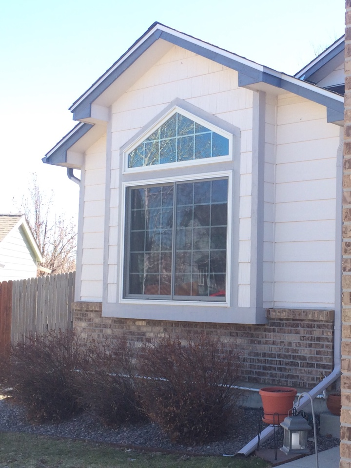 Broomfield, CO - Fantastic trapezoid speciality window with sun glass and grilles. Renewal by Andersen replacement windows added value and efficiency to this home.