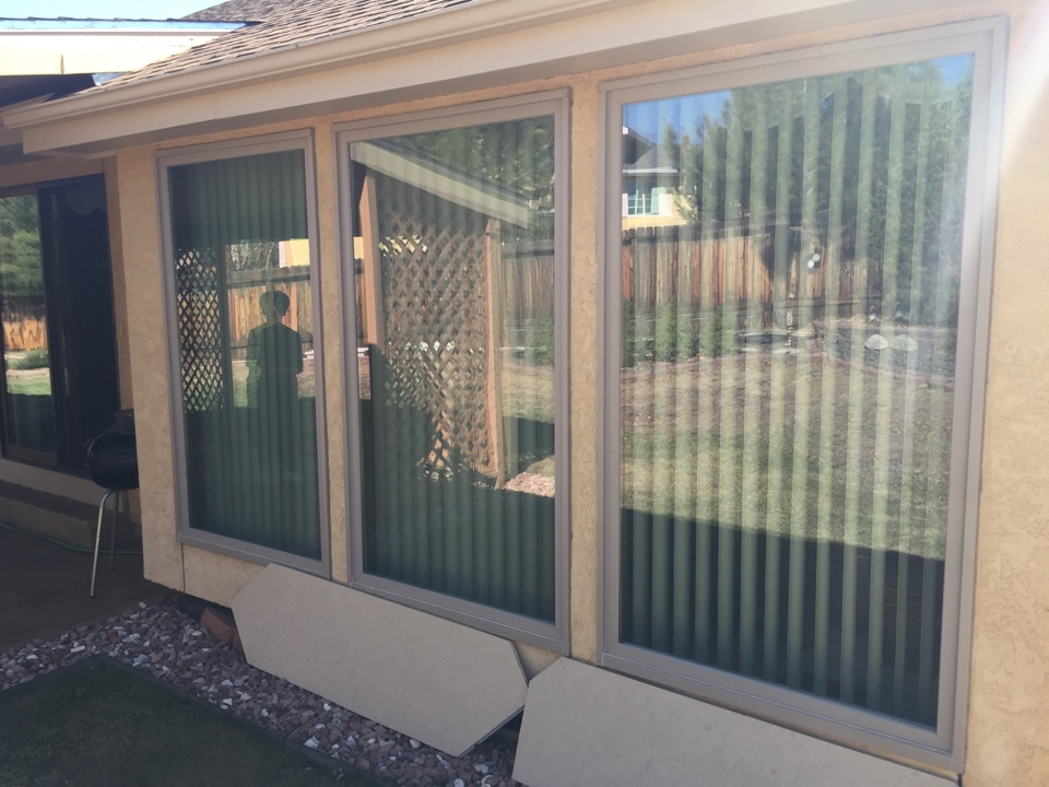 Colorado Springs, CO - 3 monster picture windows we did 3 years ago.  Customer is so happy, she just ordered a Renewal by Andersen sliding door today.