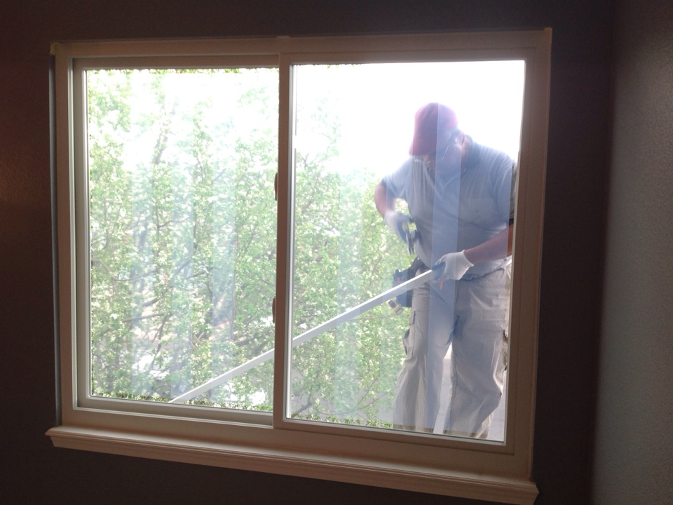Littleton, CO - Check out one of Renewal by Andersen's skilled installers risking life and limb to make sure to get the beautiful window replacement done correct. Clients thrilled with professionalism, expertise, and care that was taken during installation!