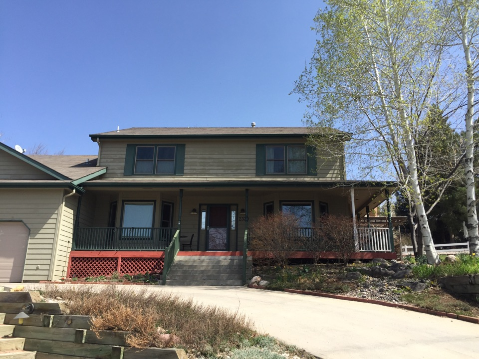Loveland, CO - Phase two complete of beautiful Renewal by Andersen windows with Low-E glass, energy efficient sandstone colored fibrex and finished with forest green exterior.