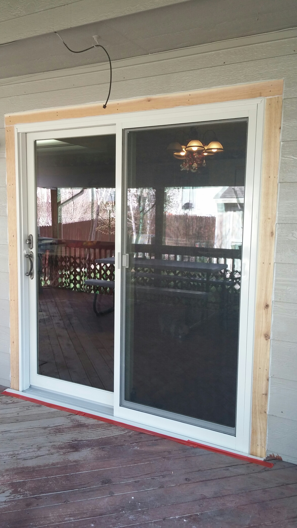 "Centennial, CO - Replaced a poorly built and installed French wood patio door with a Renewal By Andersen Narroline door. Also replaced original warped vinyl windows with our Fibrex composite windows. ""Absolutely stunning! Great quality and installation."""