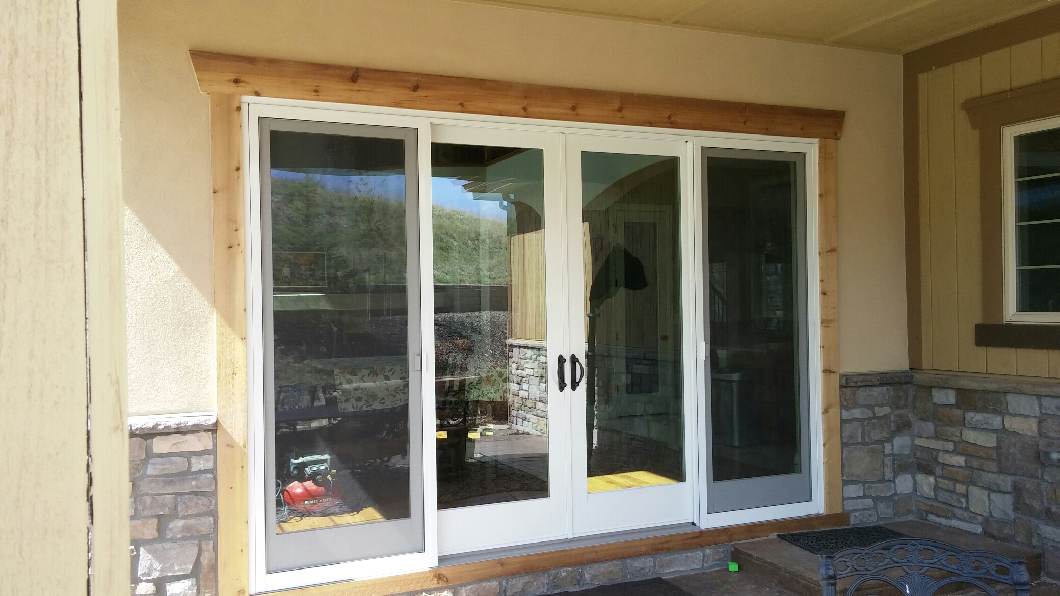 Aurora, CO - Replaced some warped vinyl windows due to seal failure and replaced a single French wood door for a four panel French wood glider with Renewal By Andersen. Absolutely beautiful transformation!