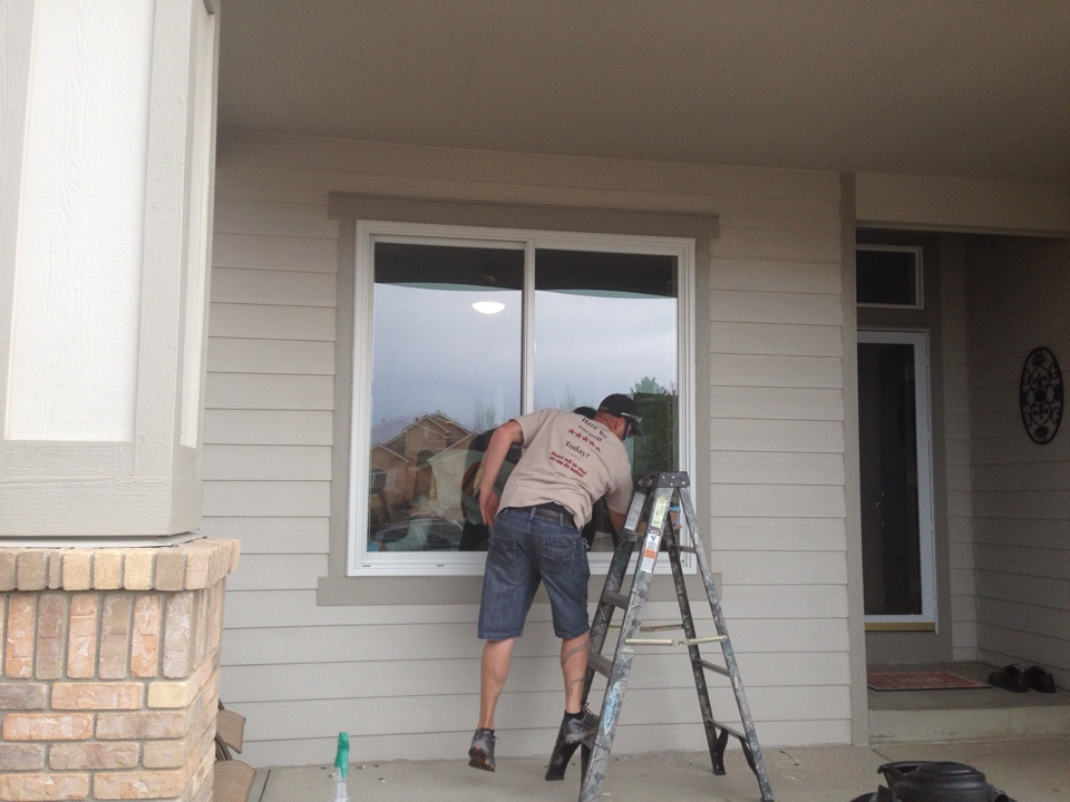Colorado Springs, CO - Just wrapping up another impeccable installation of EnergyStar Rated Renewal by Andersen Replacement Windows. The homeowners are super excited about how beautiful their new windows look compared to the originals and can't wait to finish up the rest of the house. Finishing up our 5 Star Service with cleaning the windows off after final caulking.