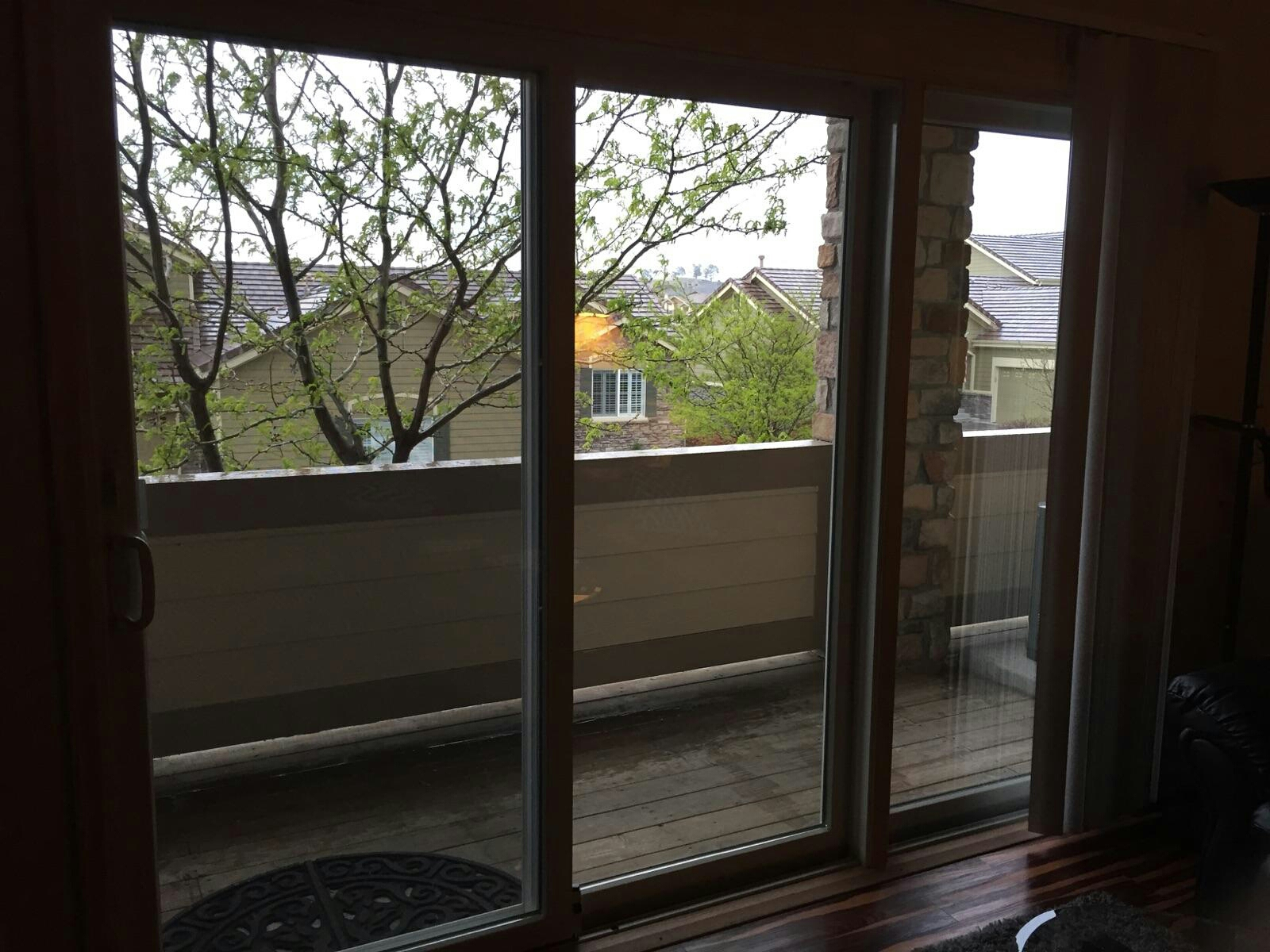 Aurora, CO - Renewal by Andersen Permashield gliding patio door. My customer says its a perfect addition to the house, the installers went above and beyond . The project manager was exceptional and she can't wait to do the windows next year. The street noise is finally silent and no more drafts
