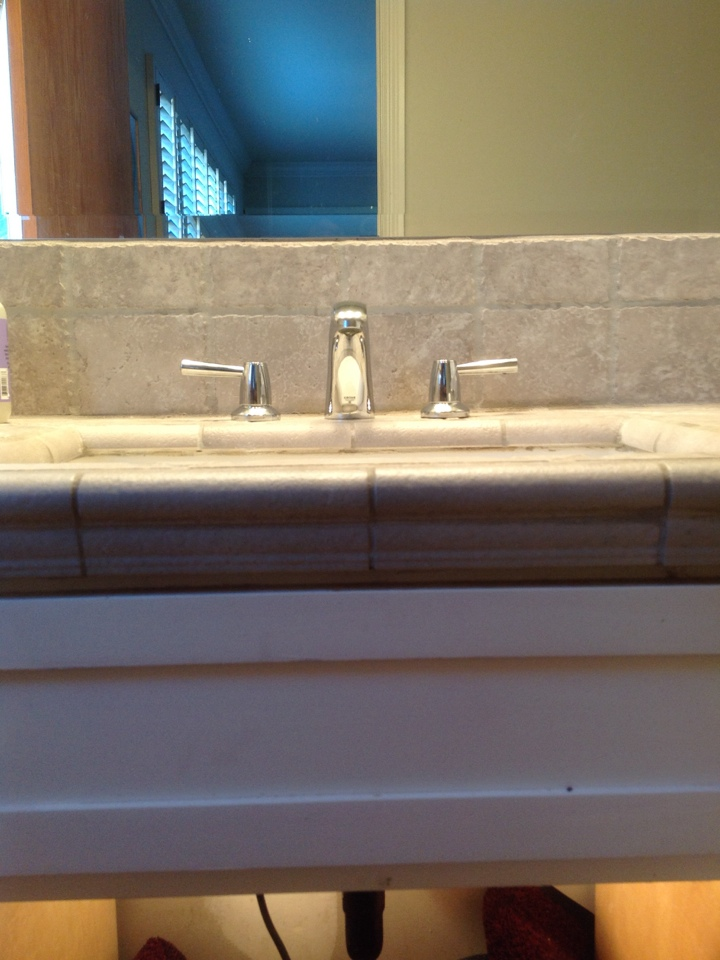 Burlingame, CA - Replaced/installed Grohe bath sink faucet with pop up assembly in master bathroom.