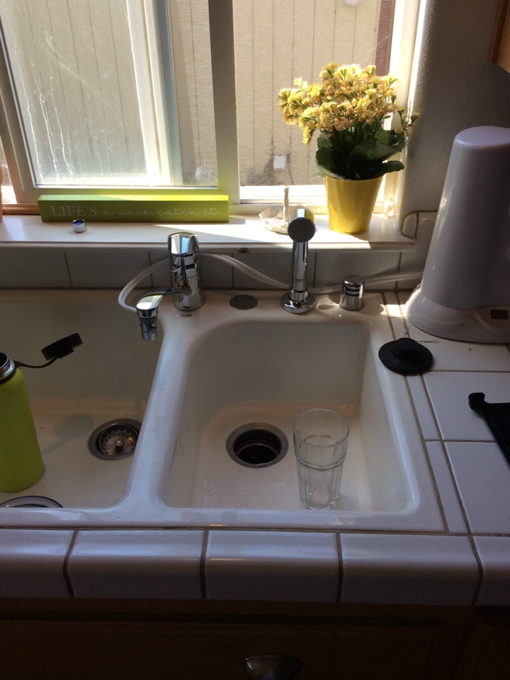 Half Moon Bay, CA - Plumber install new Grohe Eurosmart chrome kitchen faucet with Side spray.