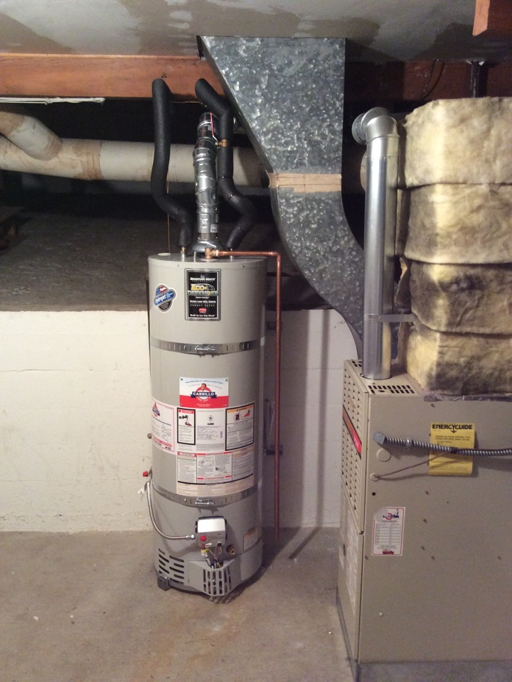 Palo Alto, CA - Plumber installed new Bradford White 40 gallon water heater with new double wall vent pipe from water heater up and through the roof. Old asbestos vent pipe removed by an asbestos abatement company.