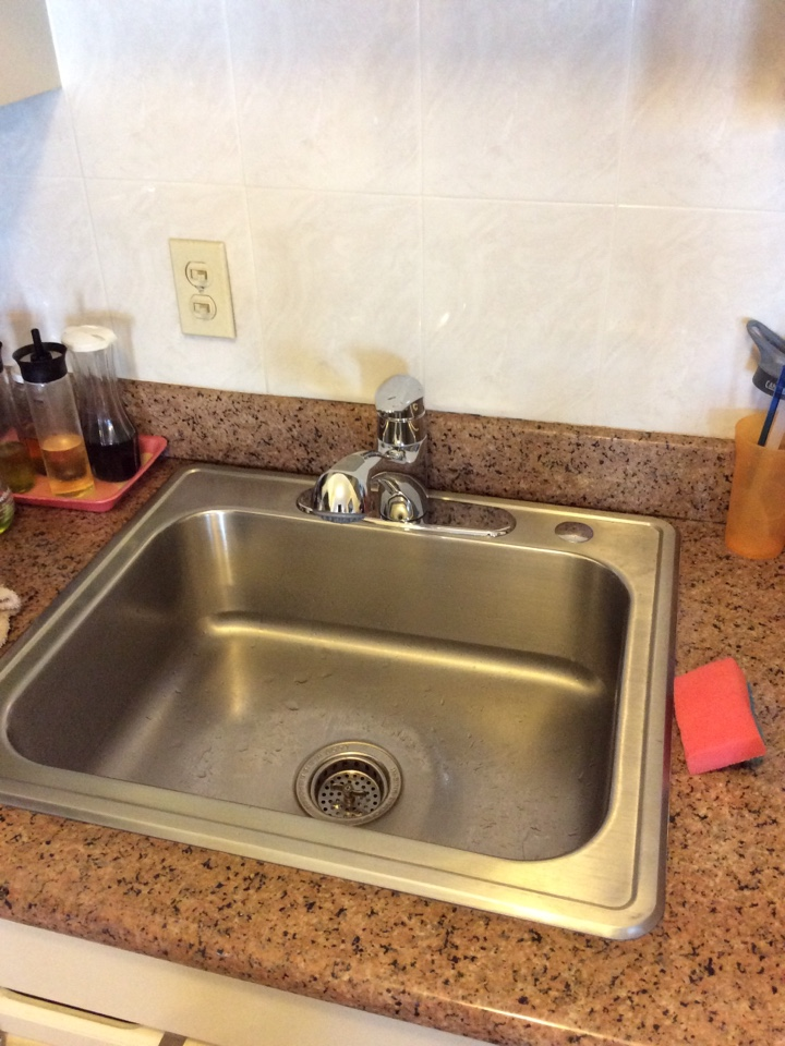Plumber install. New Grohe Eurodisc kitchen sink faucet.