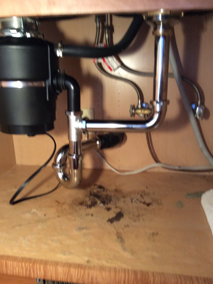Burlingame, CA - Plumber install new Insinkerator 3/4 horse power garbage disposal, 17 gauge P Trap, end outlet continuous waste and heavy duty basket strainer for double bowl kitchen sink.