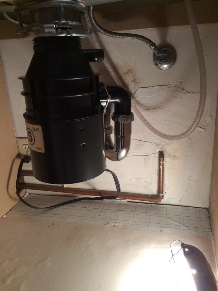 Plumber installed new Insinkerator 1/2 horse power garbage disposal.
