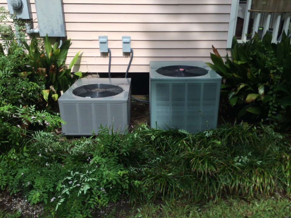 Saint Gabriel, LA - Air conditioning service St Gabriel on 2014 Rheem outside condenser and coil. preformed Spring Summer maintenance, tune up and cleaning.