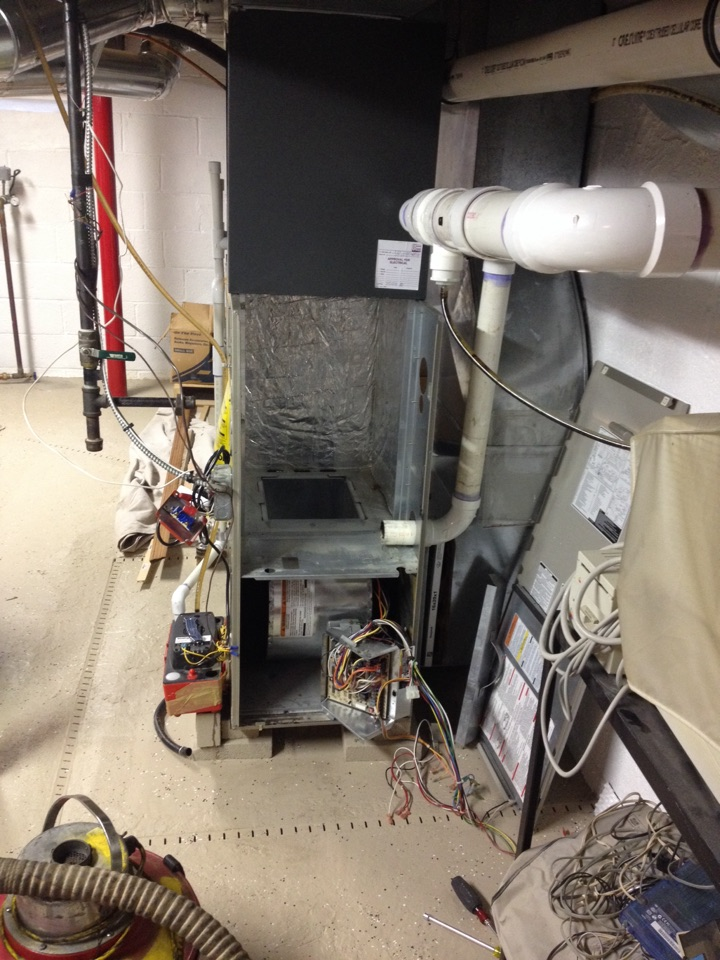 Replace clogged heat exchanger in gas furnace