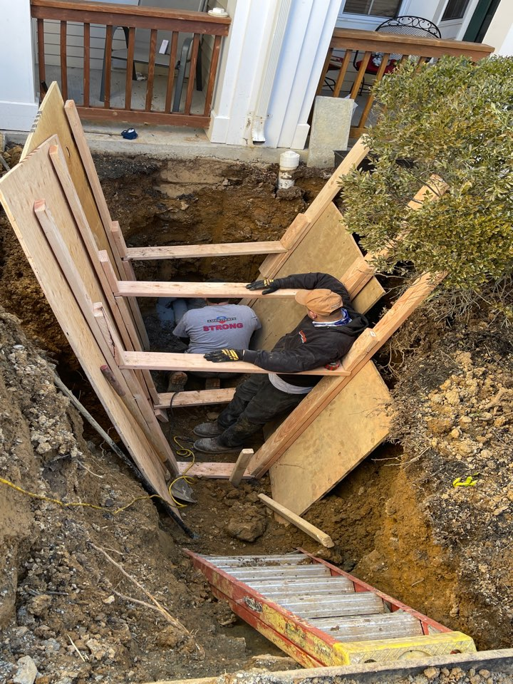 Dig up and replace sewer line through foundation.